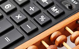 Calculator and abacus close up.